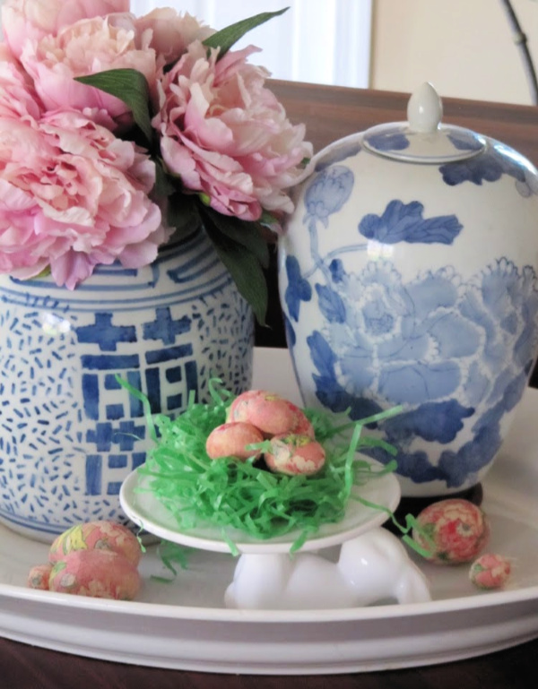 white ceramic tray with two chinoiserie vases and a cake plate with grass and Easter eggs