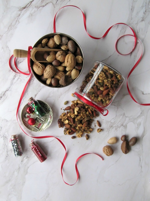Mixed nuts in a glass jar with ribbon