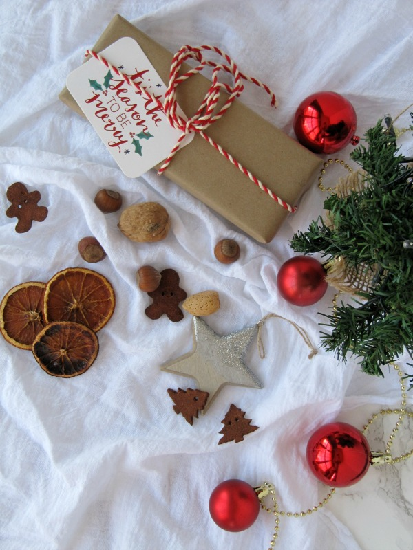 Christmas gifts with small tree ornaments and nuts