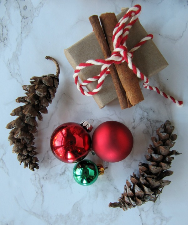 Brown paper packages-pinecones and christmas ornaments