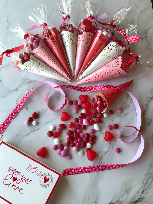 Red, white and pink paper cones filled with valentines day candy