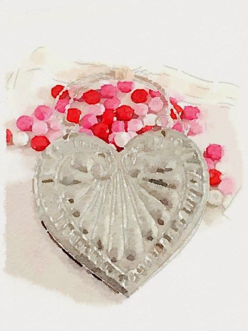 Watercolor picture of a silver heart filled with pink red and white candy