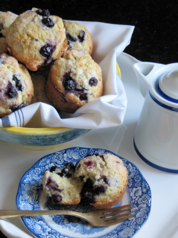 blueberry muffins in a white napkin lined bowl