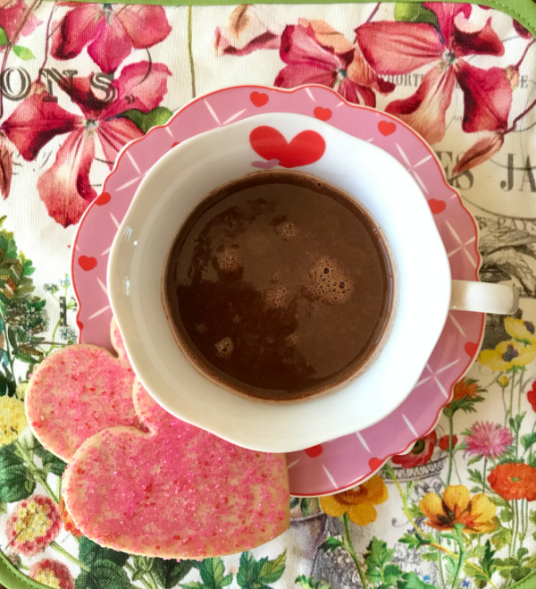 Cup of hot chocolate with heart shaped cookies
