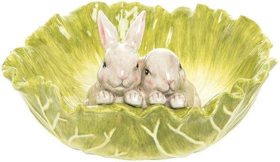 Two bunnies in a lettuce shaped bowl