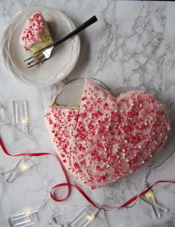 Heart shaped cake with piece on a plate