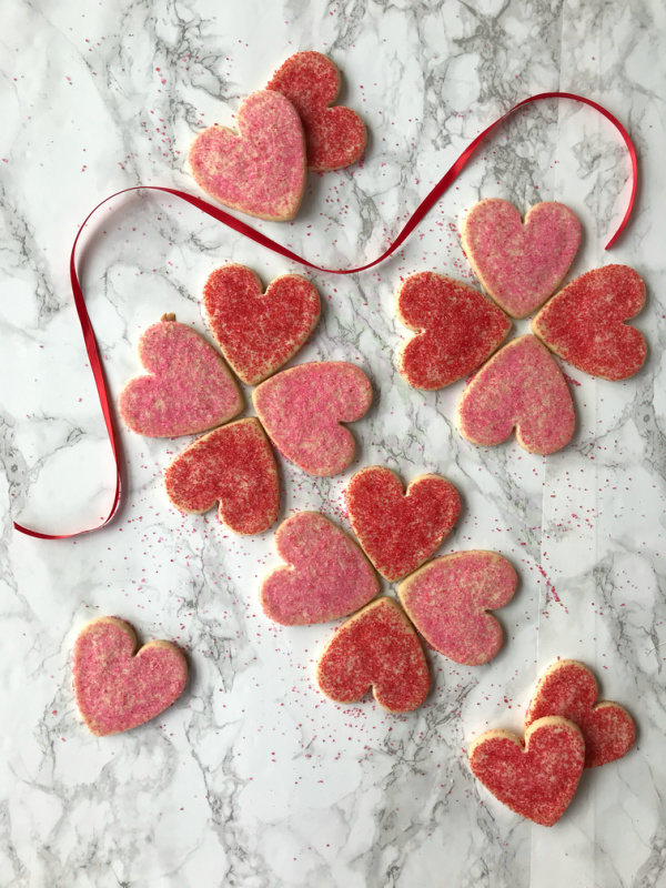 heart shaped cookies with red and pink sugar