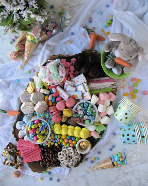 easter candy cookie cake charcuterie board with peeps