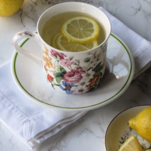 flowered cup with lemons floating in it