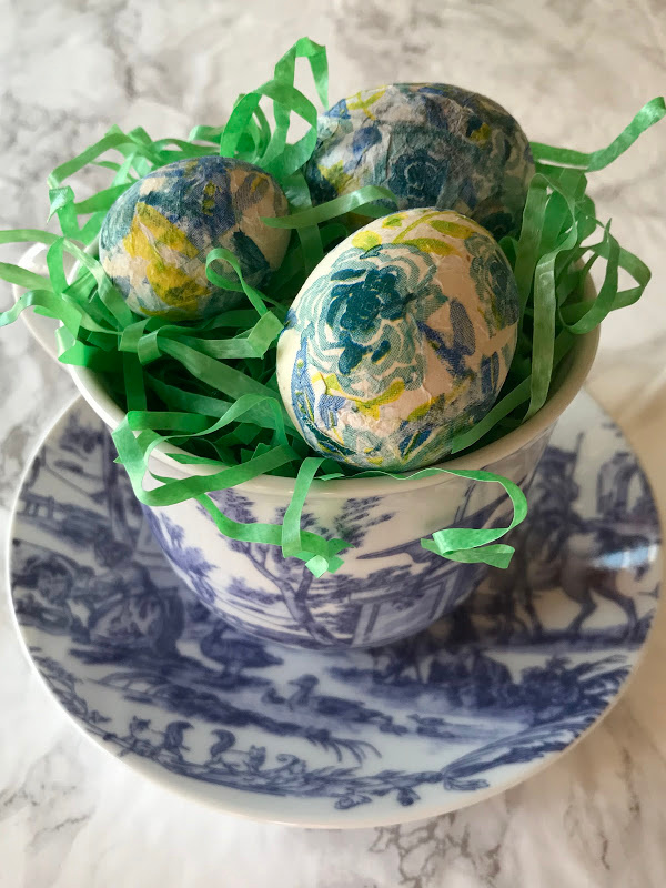 decoupage eggs in a toile cup and saucer